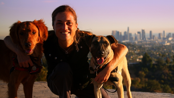 Lisa Filpi, on a trek in Griffith Park with Sandy, a Golden Retriever, and Ruby, a Chow-Shepard mix.